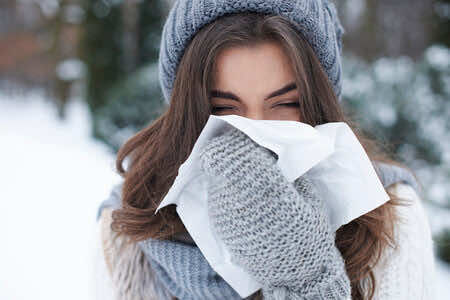 cold woman sneezing tissue