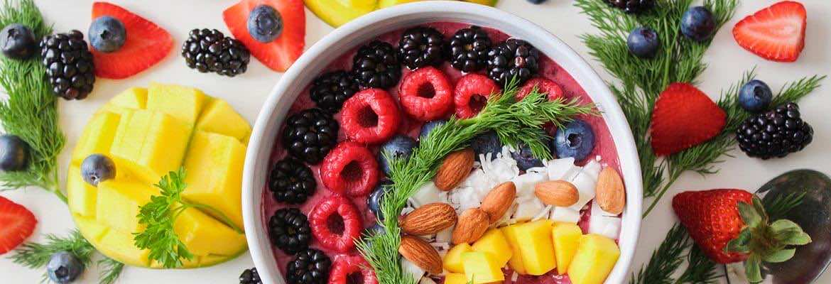 a bowl filled with colourful fruits | vegan blood test | London Doctors Clinic