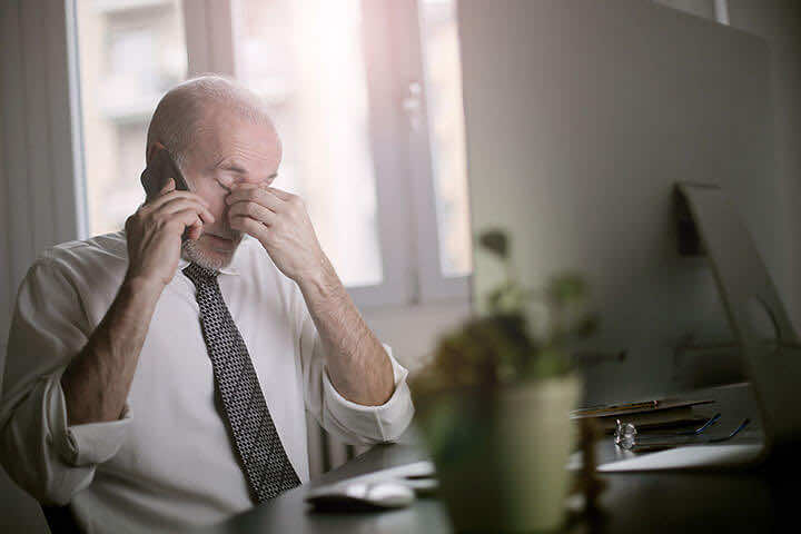 Business man looking stressed | Workplace stress | London Doctors Clinic